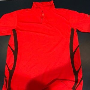 Red and black kids Nike golf shirt